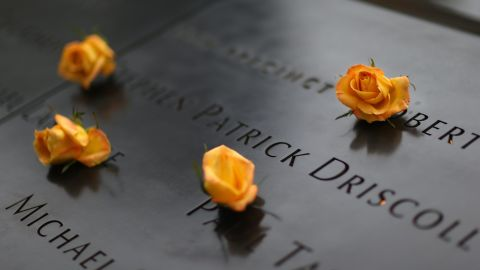 Flowers are placed over names of vicitims of September 11, 2001 at the South Tower Memorial Pool before memorial observances are held at the site of the World Trade Center on September 11, 2014 in New York City.