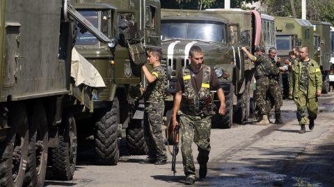 A column of Ukrainian forces is seen in Volnovakha, Ukraine, on September 11.