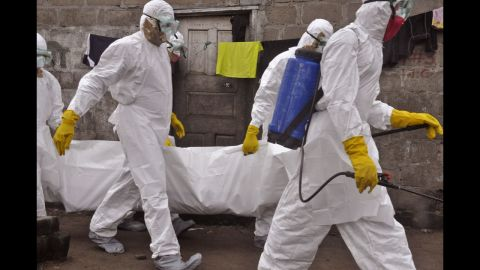 Health workers on Wednesday, September 10, carry the body of a woman who they suspect died from the Ebola virus in Monrovia, Liberia. Health officials say the current Ebola outbreak in West Africa is the deadliest ever. More than 4,200 cases have been reported since December, with more than 2,200 of them ending in fatalities, according to the World Health Organization.