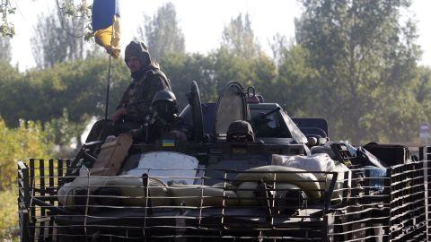 Ukrainian soldiers ride on an armored vehicle near Kramatorsk, Ukraine, on September 13.