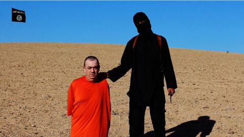 Alan Henning ispictured with an ISIS member in a frame taken from a video released by ISIS.