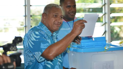 """Fiji's leader Voreqe """"Frank"""" Bainimarama casts his vote in the country's first election in eight years."""