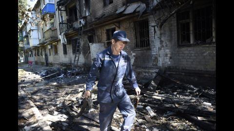 A firefighter walks past the rubble of a building destroyed by shelling in Donetsk on Wednesday, September 17.