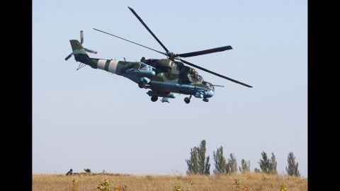 A Ukrainian helicopter patrols an area near Donetsk on September 20.