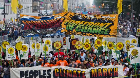 People gather near Columbus Circle before the People's Climate March in New York on Sunday, September 21. People from around the world are participating in what's billed as the largest march ever calling for action on global warming.