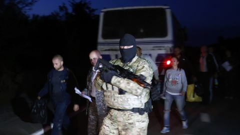 A Ukrainian soldier guards pro-Russian rebels during a prisoner exchange near Donetsk on September 21.
