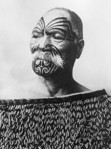 A Maori chief from New Zealand, circa 1950, with the traditional facial tattoos.