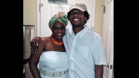 This undated photo provided by his family shows John Crawford III, right, with his mother, Tressa Sherrod.  (AP Photo/Courtesy family of John Crawford III)