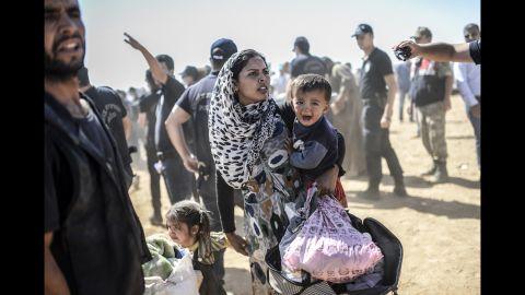 A Kurdish woman crosses into Suruc on Tuesday, September 23.