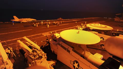 An F/A-18C Hornet prepares to take off from the flight deck of the USS George H.W. Bush, a U.S. Navy aircraft carrier in the Persian Gulf, before conducting strike missions against ISIS targets on September 23.