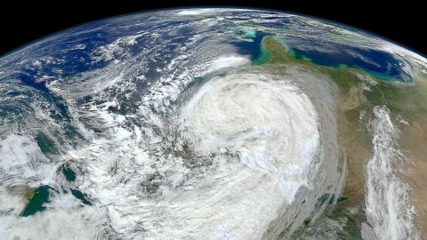 """The planet could see as many as 20 more hurricanes and tropical storms each year by the end of the century because of climate change, according to <a href=""""http://www.pnas.org/content/110/41/16361.full.pdf+html"""" target=""""_blank"""" target=""""_blank"""">a 2013 study</a> published in the Proceedings of the National Academy of Sciences. This image shows Superstorm Sandy bearing down on the New Jersey coast in 2012."""