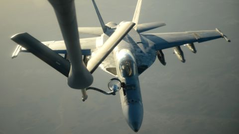 """A U.S. Navy jet is refueled in flight after airstrike missions in Syria on September 23. In addition to bombing ISIS, the United States has also taken action -- on its own -- against another terrorist organization, the Khorasan Group. U.S. President Barack Obama described Khorasan members as """"seasoned al Qaeda operatives in Syria."""""""