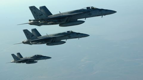 """In this photo released by the U.S. Air Force, fighter jets fly over northern Iraq as part of coalition airstrikes in Syria on Tuesday, September 23. The United States and several Arab nations <a href=""""http://www.cnn.com/2014/09/23/world/meast/isis-airstrikes/index.html"""">have started bombing ISIS targets</a> in Syria to take out the militant group's ability to command, train and resupply its fighters."""