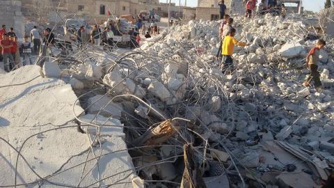 This photo, released by activists in Idlib, Syria, on September 23, shows what they say is the aftermath of U.S. airstrikes against ISIS.