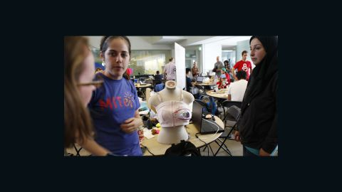 """A group works on their alternative pump at the """"Make the Breast Pump Not Suck"""" hackathon at MIT."""