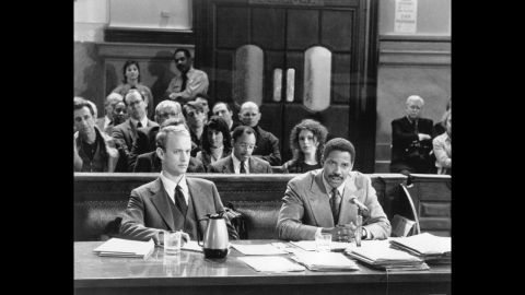 """<strong>""""Philadelphia"""" (1993)</strong>: The wonder of a Washington performance is that he can play an abrasive character and not make you hate him (at least, not completely). In """"Philadelphia,"""" the story of a lawyer (Tom Hanks, foreground left) who sues when his firm discriminates against him for his HIV status, Washington plays the attorney who represents him and who is as bigoted (initially, at least) as the lawsuit's defendants."""