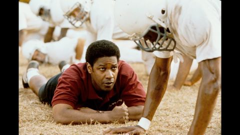 """<strong>""""Remember the Titans"""" (2000)</strong>: Yes, this is a Disney film through and through, right on down to synchronized dance routines and a feel-good ending. But Washington's Coach Boone is impossible not to love here, and his firm but gracious approach to uniting a freshly integrated football team will probably make you cry. Just a warning."""