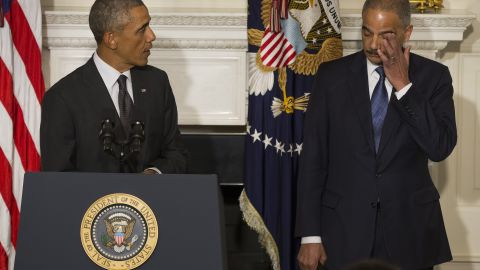 """Holder wipes away tears in September 2014 as <a href=""""http://www.cnn.com/2014/09/25/politics/eric-holder-resignation/index.html"""">his resignation is announced</a> by President Barack Obama in Washington. Holder, who led the Department of Justice for six years, stayed in the position until his replacement, Loretta Lynch, was confirmed."""
