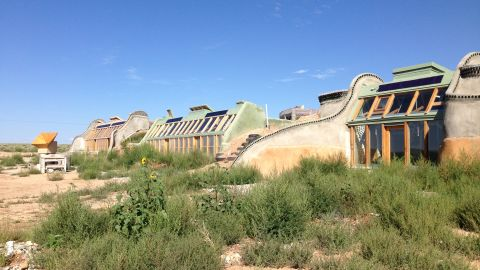 The exterior of an Earthship passive solar home.