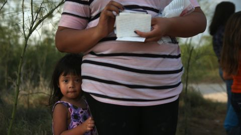 Honduran undocumented immigrant Laura Fabio, 2 waits for her mother after they crossed the Rio Grande illegally into the United States on July 24, 2014 in Mission, Texas.