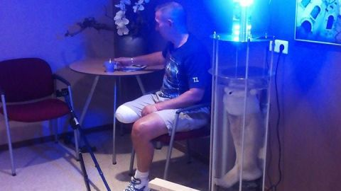 Leo Bonten sits in the glow of his new lamp ... made with his own amputated leg.