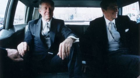 Outgoing President Jimmy Carter, left, sits with president-elect Reagan in