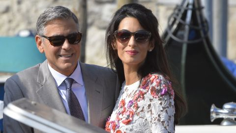"""Actor George Clooney and his wife, attorney Amal Alamuddin, stand on a taxi boat on the Grand Canal in Venice, Italy, on Sunday, September 28. Clooney and Alamuddin <a href=""""http://www.cnn.com/2014/09/29/showbiz/italy-george-clooney-wedding/index.html"""">married in Venice</a> the previous day at a private ceremony attended by celebrities."""