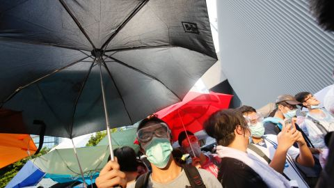 Protesters used umbrellas to block pepper spray and tear gas used by riot police.