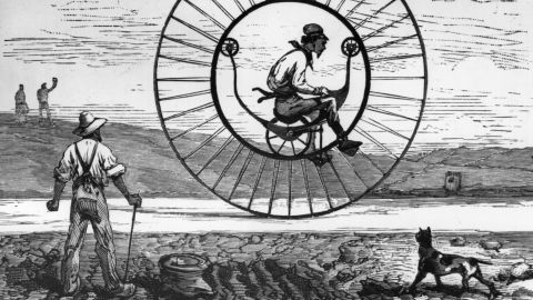 A monocycle invented by Langmark and Stuef of California from 1895, consisting of a cycle moving within a large wheel. One-wheeled transport has traditionally been difficult to steer.