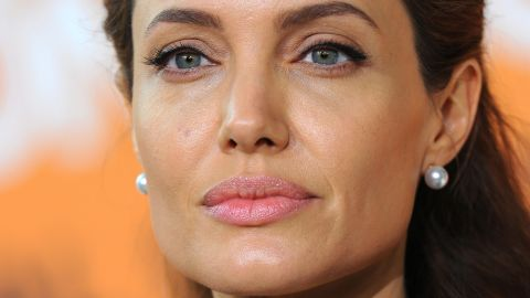 """Angelina Jolie didn't just make a fan happy; she helped comfort her. <a href=""""http://www.nydailynews.com/entertainment/gossip/angelina-jolie-comforts-crying-fan-daily-show-article-1.2034576"""" target=""""_blank"""" target=""""_blank"""">According to the New York Daily News</a>, Jolie was leaving the """"Daily Show"""" studios on December 4 when a waiting fan named Techne exclaimed that she was having a panic attack. Jolie took time to wipe her tears, signed some memorabilia and took two selfies with her."""
