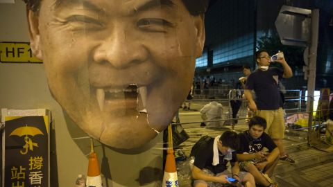 Groups of protesters gather outside the Hong Kong Government Complex in front of a poster mocking C.Y. Leung, Hong Kong's Chief Executive on September 30.