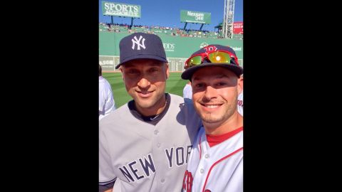 """Boston Red Sox pitcher Joe Kelly, right, snaps a selfie with retiring New York Yankees captain Derek Jeter before Jeter played the final game of his career Sunday, September 28, in Boston. Kelly <a href=""""https://twitter.com/JosephKellyJr/status/516382468854013952"""" target=""""_blank"""" target=""""_blank"""">tweeted the photo</a> with the hashtags #RE2PECT and #2ELFIE in honor of Jeter's jersey number. <a href=""""http://www.cnn.com/2014/09/22/worldsport/gallery/derek-jeter/index.html"""">See photos from Jeter's 20-year career</a>"""