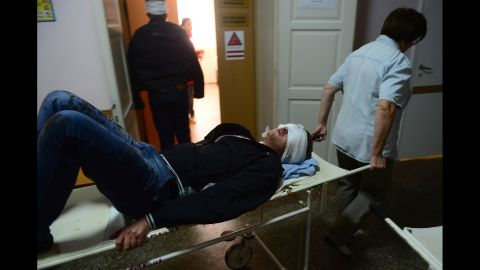 An injured man is transported at a hospital after shelling in Donetsk on Wednesday, October 1.