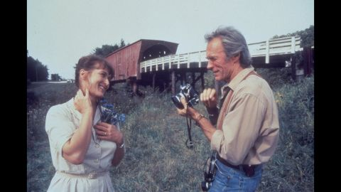 """<strong>""""The Bridges of Madison County"""":</strong> Robert James Waller's 1992 novel about the romance between a lonely Iowa farm wife and a National Geographic photographer lingered on bestseller lists for three years and sold 50 million copies. Clint Eastwood stars in (and directs) the 1995 movie version with Meryl Streep."""