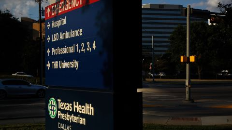 Caption:DALLAS, TX - SEPTEMBER 30: Traffic moves past Texas Health Presbyterian Hospital Dallas where a patient has been diagnosed with the Ebola virus on September 30, 2014 in Dallas, Texas. The patient who had recently traveled to Dallas from Liberia marks the first case of this strain of Ebola that has been diagnosed outside of West Africa. (Photo by Mike Stone/Getty Images)