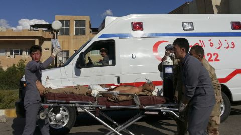 A Kurdish Peshmerga soldier who was wounded in a battle with ISIS is wheeled to the Zakho Emergency Hospital in Duhuk, Iraq, on Tuesday, September 30.