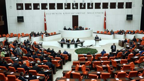 Turkish Parliament members convene to vote on a motion submitted by the government seeking a green light for the use of Turkish troops in the neighbouring countries as well as for foreign forces to transit Turkish territory in operations against Islamic State (IS) jihadists, at the Parliament in Ankara on October 2, 2014. The debate comes after President Recep Tayyip Erdogan last week indicated Turkey was shifting its policy to take a more active role in the fight against IS militants, who have advanced to within a few kilometres of the Turkish border in northern Syria. AFP PHOTO/ADEM ALTAN        (Photo credit should read ADEM ALTAN/AFP/Getty Images)