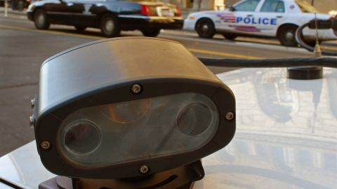 A 'license plate reader'  is mounted on a police car in Washington, D.C. It automatically records license plates of cars going by.