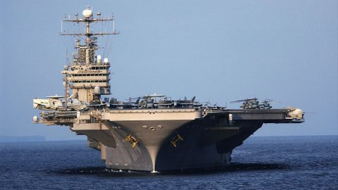 The USS Abraham Lincoln, a Nimitz-class aircraft carrier, is seen near the coast of Indonesia in 2005. The carrier recently received a new anchor from the decommissioned USS Enterprise.