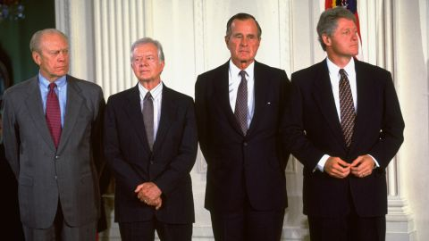 From left, Former Presidents Gerald Ford, Jimmy Carter and George H.W. Bush join Clinton at the White House for the signing of the North American Free Trade Agreement in September 1993.