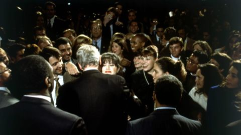 White House intern Monica Lewinsky embraces Clinton at a Democratic fundraiser in Washington, DC, in October 1996.