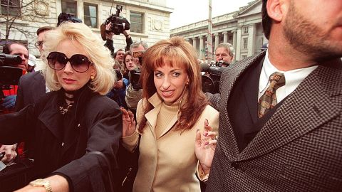 """Paula Jones, center, arrives at the office of a lawyer representing Clinton in January 1998. The former Arkansas state employee filed a federal civil lawsuit in 1994 accusing Clinton of making """"persistent and continuous"""" unwanted sexual advances during a conference in 1991, when he was governor. The President agreed to an $850,000 settlement in November 1998."""