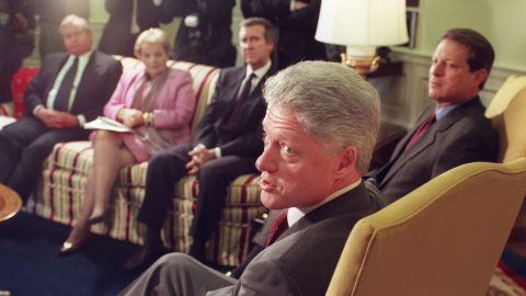 Clinton answers questions from reporters in December 1998 before the start of a meeting with his foreign policy team. After a December 16 military strike on Iraq, Clinton warned Iraqi President Saddam Hussein against threatening his neighbors. Clinton also indicated his determination to complete the operations that continued the next day with renewed bombing of Iraqi sites suspected of housing parts to manufacture weapons of mass destruction.