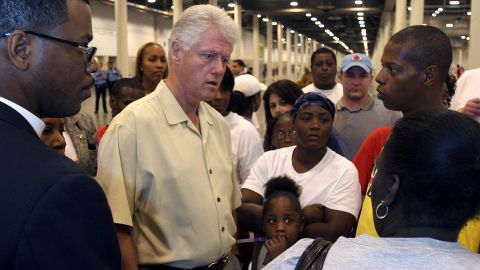 Clinton visits Hurricane Katrina evacuees in Houston in September 2005. That same day, Clinton and former President George H.W. Bush announced the formation of the Bush-Clinton Katrina Fund to assist victims.
