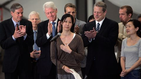 Journalist Laura Ling speaks in front of Clinton, former Vice President Al Gore and Euna Lee in August 2009, after she and Lee were released by North Korean authorities. Ling and Lee were arrested by North Korea for illegally entering the country on the Chinese border. They were pardoned by President Kim Jong-Il after a meeting with Clinton. Ling and Lee had been sentenced to 12 years in prison.