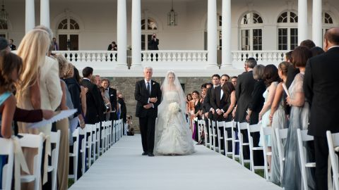 The former President walks his daughter down the aisle during her wedding to Marc Mezvinsky in July 2010.