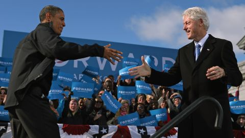 Clinton welcomes President Barack Obama to the stage during a campaign rally in New Hampshire in November 2012.