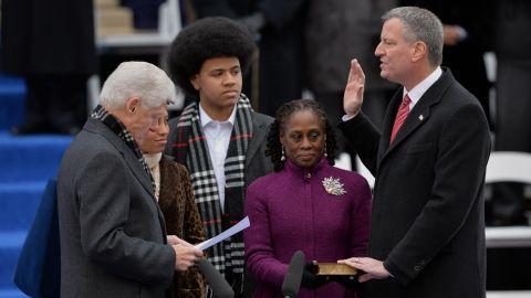 Clinton swears in New York City Mayor Bill de Blasio in January 2014.