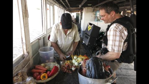 A cook aboard the Cacique II prepares lunch of local river fish.