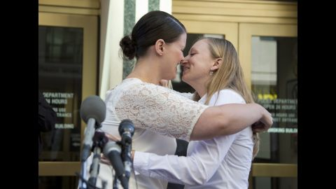 Jennifer Melsop, left, and Erika Turner kiss after they were married in front of the Arlington County Courthouse in Arlington, Virginia, on October 6, 2014.